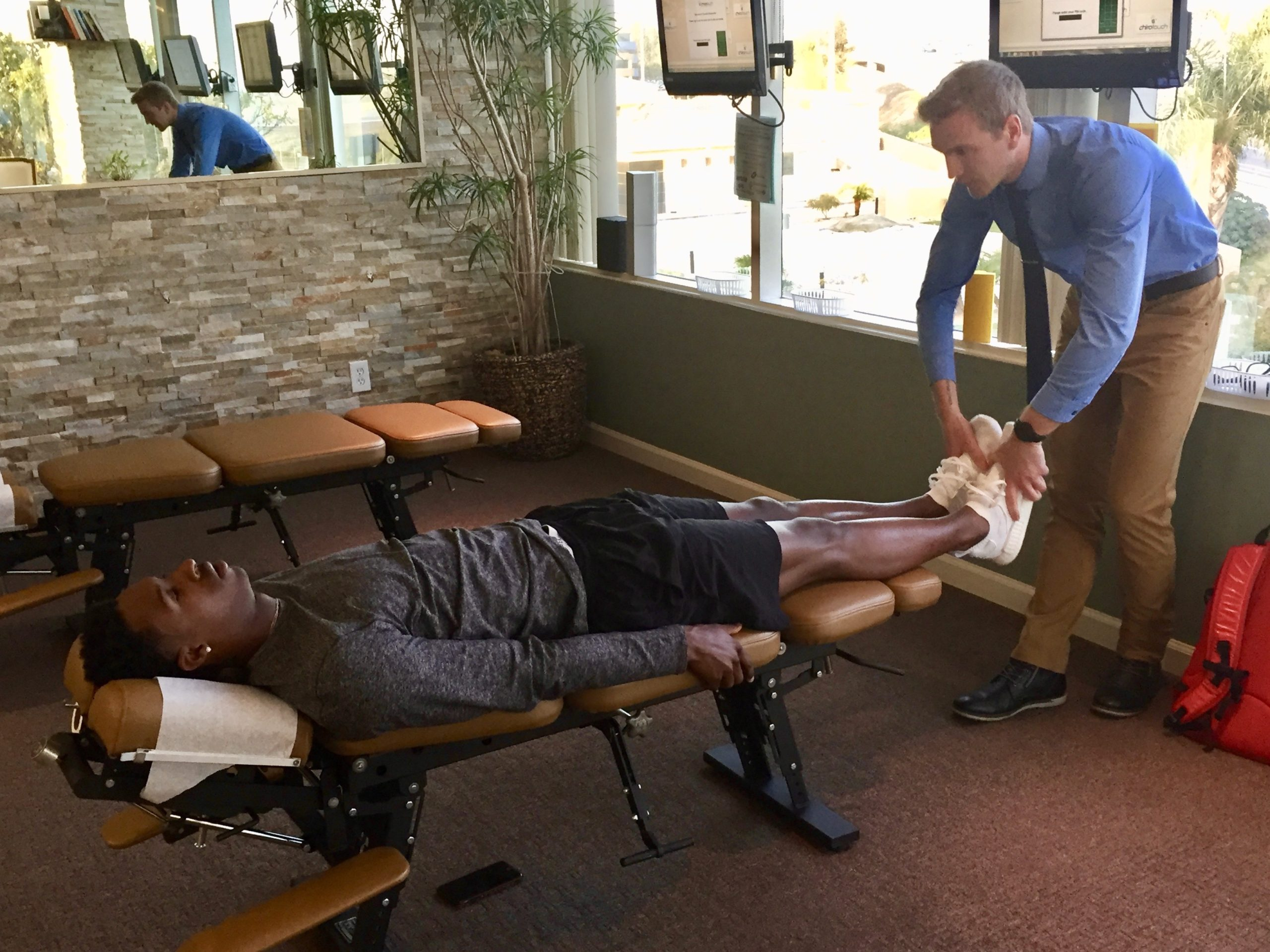 Dr Carlson giving a Chiropractic Adjustment To Patient